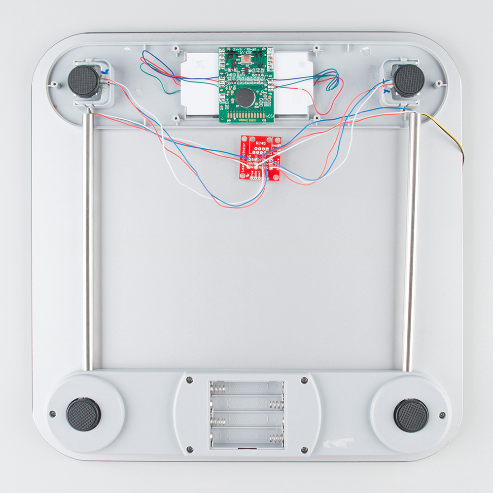 Bathroom scale with four cells shown connected to combinator board