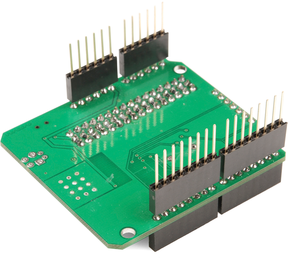 Arduino Shields Electronic Components Including Circuit Boards Sit In A Pile Before Stackable Headers Inserted Into Shield Jig
