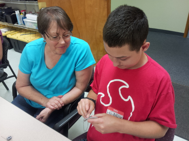 Henry and his mom working on the firefly jar together
