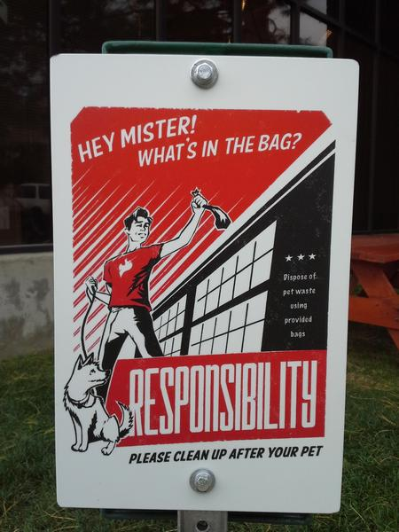 This sign, designed by our own designer Pete, accompanies a poop bag dispenser in a high-traffic area