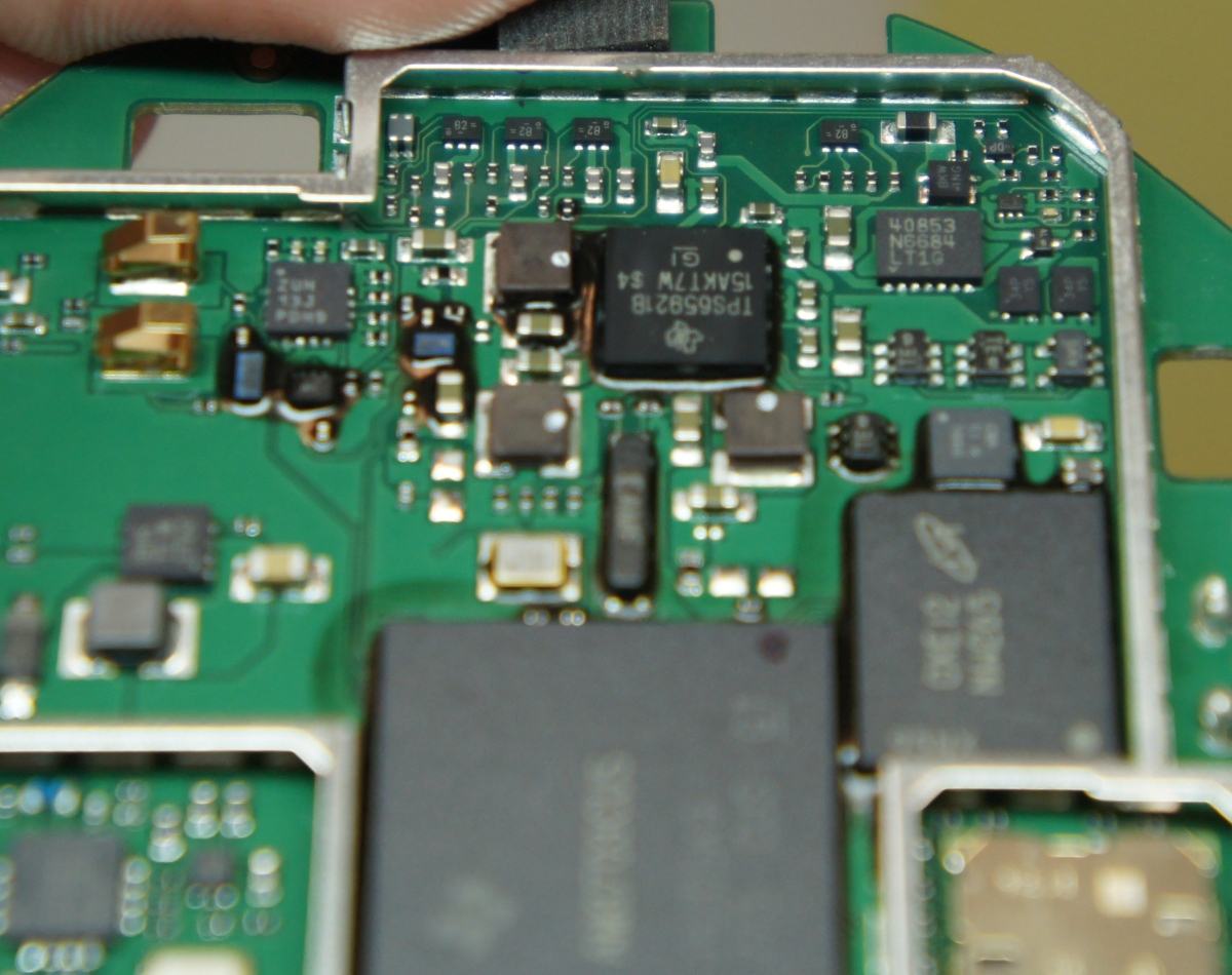 Nest Thermostat Teardown Green Electrical Circuit Board With Microchips And Transistors Royalty Alt Text