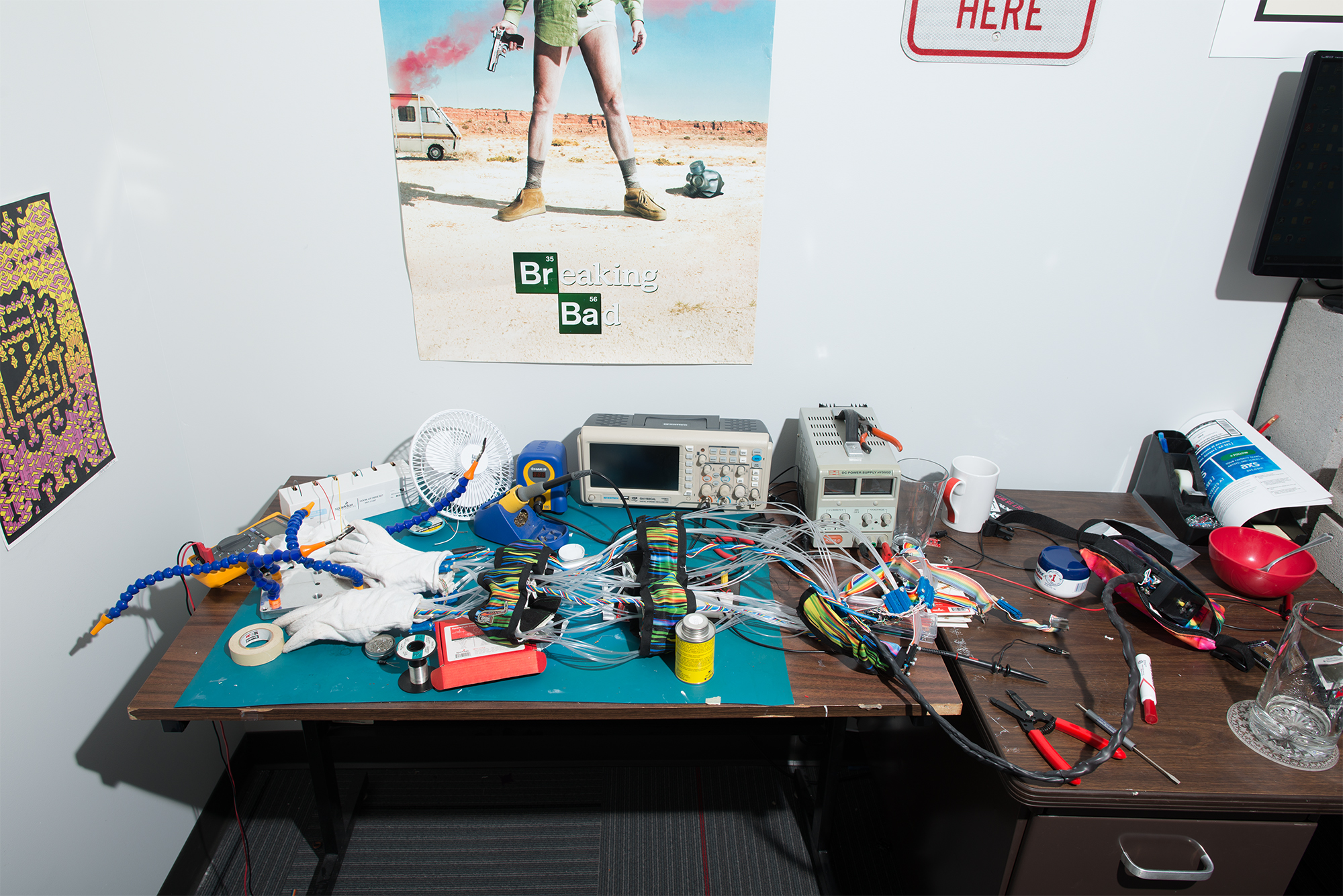 photos of engineer's workbench with hook-up wire dispenser