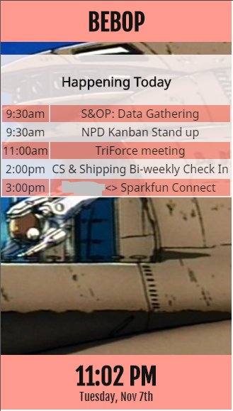 screenshot of the application showing the meeting room name at top followed by the agenda (partially redacted) and the current date and time at the bottom