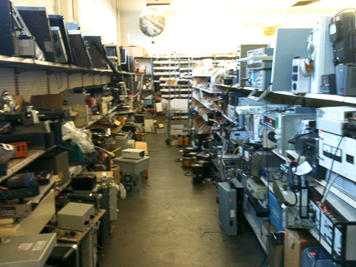 An aisle precariously filled with test equipment