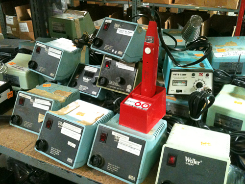 A pyramid of old soldering stations