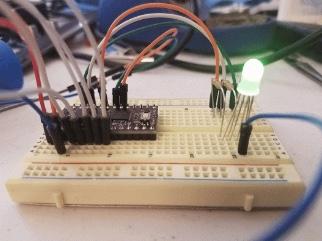 LoFive in breadboard blinking an RGB LED