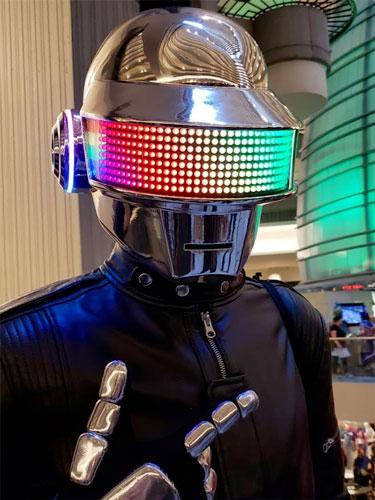 Nathaniel posing wearing his Daft Punk LED helmet