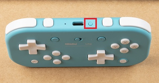 Pair button at the top of the controller is highlighted