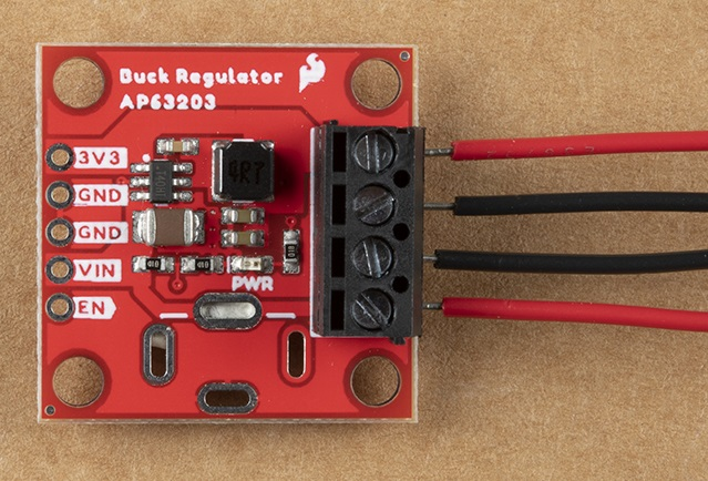 Screw terminals on the right side of the Buck Regulator Board with wires inserted and screws tightened