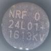 Microscope detail of a label showing the part number NRF 24L01+