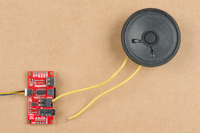 Inserting tinned speaker wires into the Qwiic MP3 Trigger