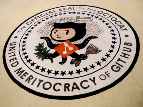 "GitHub's former rug. The flawed ""United Meritocracy of GitHub"" has been supplanted by ""In collaboration we trust"""