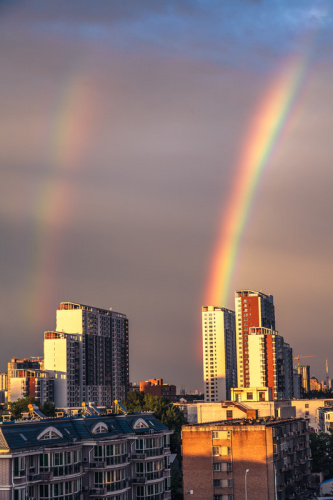 rainbows ending in a city