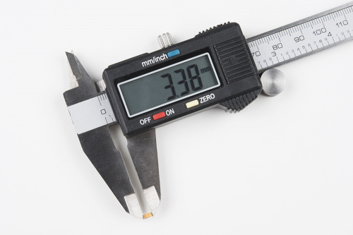 Using digital calipers to measure electrical components