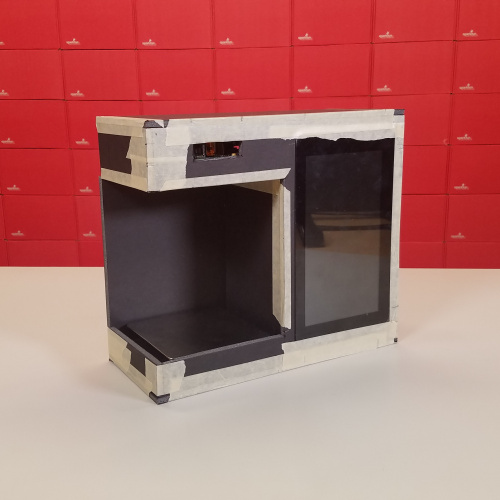 Picture of the initial enclosure made from foamboard and masking tape