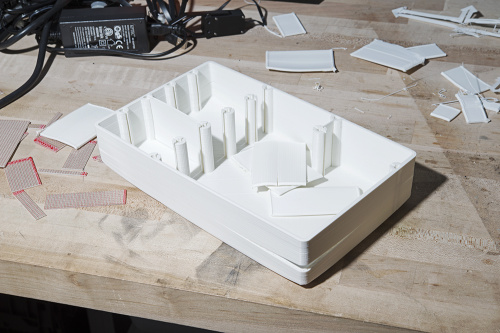photo of a failed 3D print of the model with a large crack in the side from de-lamination and warped dividers