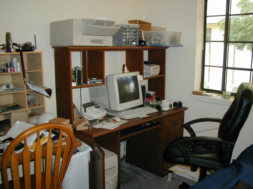 Old SparkFun office with computer and printers