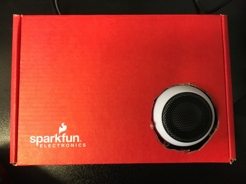 The final product boxed in a red box with a port for the speaker