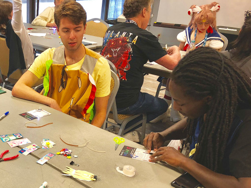 Participants creating paper circuits