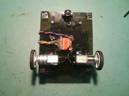 Bottom of Hackbot, motors and driver mounted with hot glue.