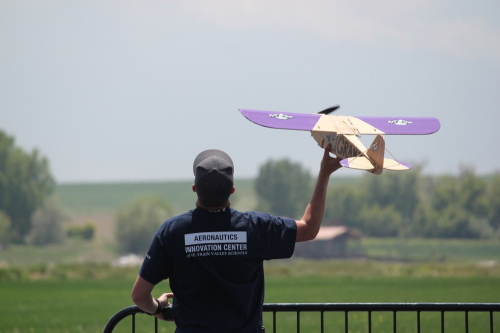 Jake Marshall hand launches a DIY foam board plane its just about to break free from his hand