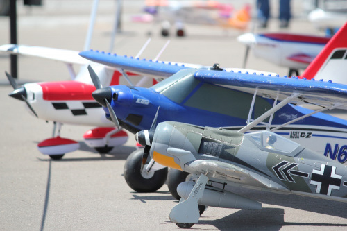 a few airplanes lined up on the taxiway for the audience to look at