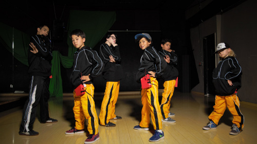 EL Hoodie and Pants Worn on Dancers in Front of a Spot Light