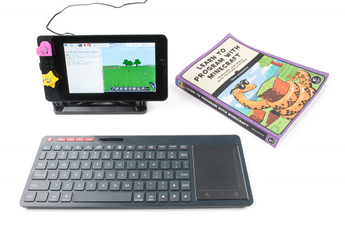 image of minecraft book and screen and keyboard next to it