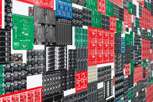 A wall of flawed PCBs