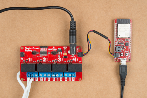 This image shows a picture of SparkFun's ESP32 thing Plus and Quad Relay connected together with a Qwiic connector, each being powered through a wall wart.