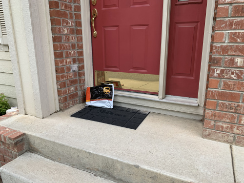 International Shipping Package in front of Door