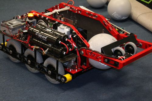 Example of an engineering prototype with many components such as wheels, chassis, lights, and other electronics