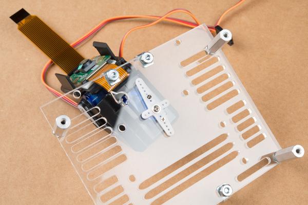 Pan-tilt mechanism mounted to mounting plate