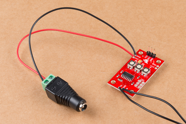 Photo showing wire soldered to the VCC and GND pins on Servo Trigger and connected to DC Barrel Jack Adapter