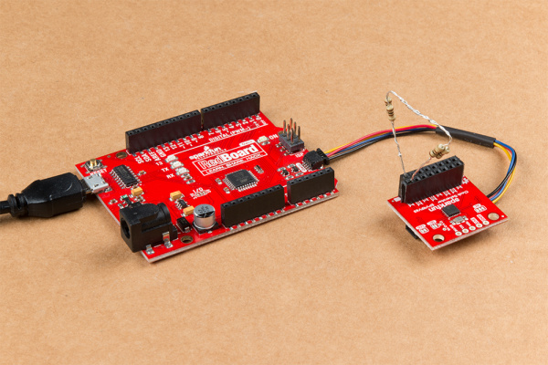 This image shows the SparkFun Clock Generator plugged into the Redboard Qwiic using a Qwiic cable.