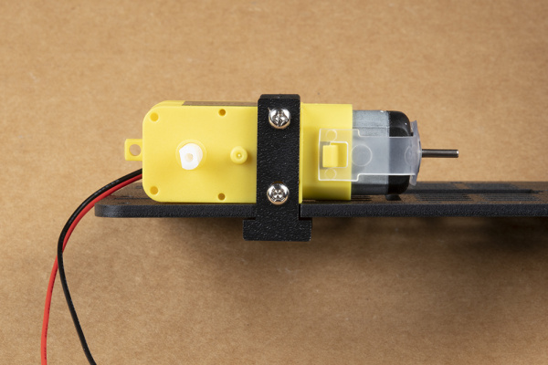 First motor secured to chassis