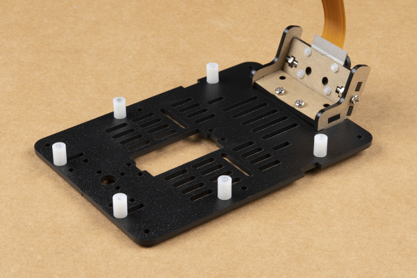 Six plastic standoffs attached loosely to mounting plate