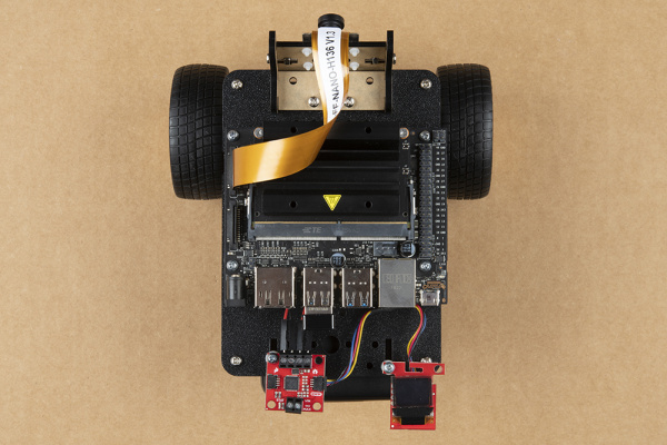 Qwiic Micro OLED mounted and connected to Qwiic Motor Driver