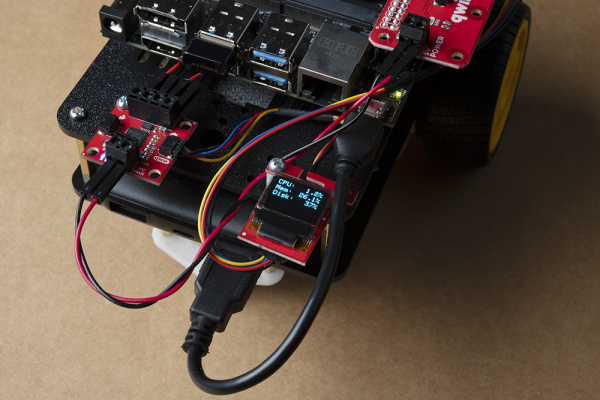 JetBot powered on and micro OLED displaying disc space