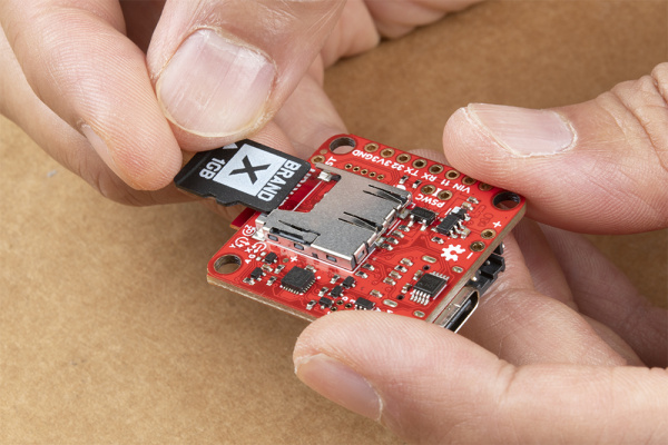 microSD card being inserted into microSD Card socket