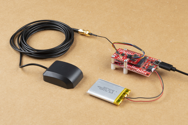 A completed GPS logging circuit with USB, Battery and GPS antenna attached.