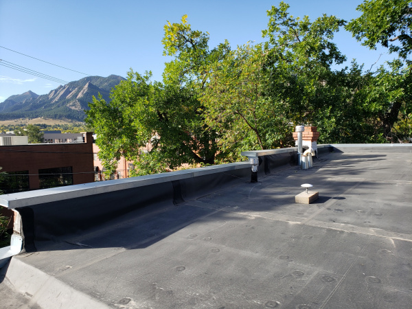 Antenna on roof with Boulder Flatirons