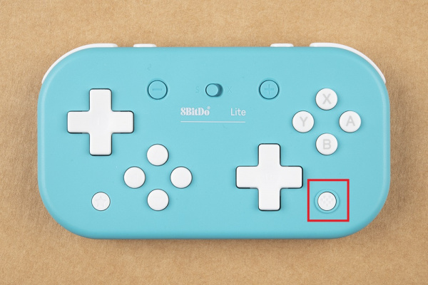 Home button is on the lower right of the controller