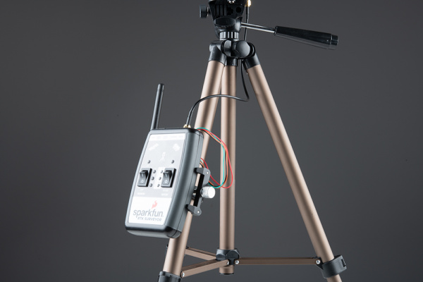 Cell phone clamp on the side of a tripod with RTK Surveyor