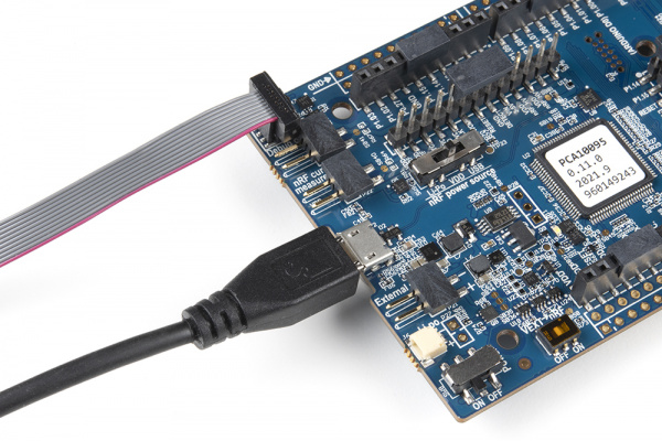 The JTAG cable is directional and has a tab on the side that will keep you from inserting it incorrectly