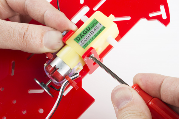 Using screwdriver to tighten screw