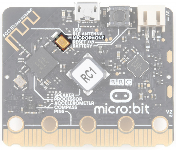 The microphone is on the back of the board, just below and left of the USB port