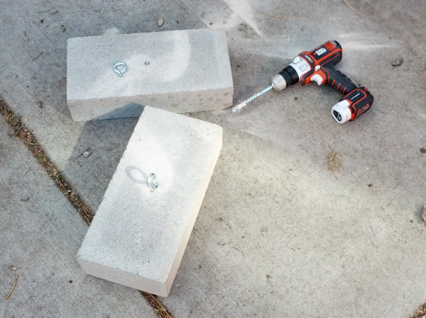 Ballast concrete blocks with broken eye-bolt