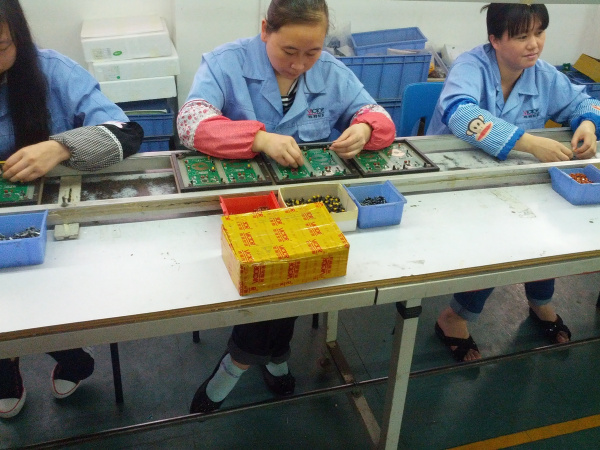 Workers putting together DMMs