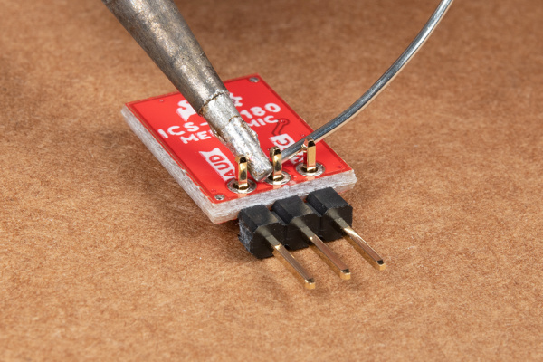 Right angle header pins being soldered to MEMS microphone.